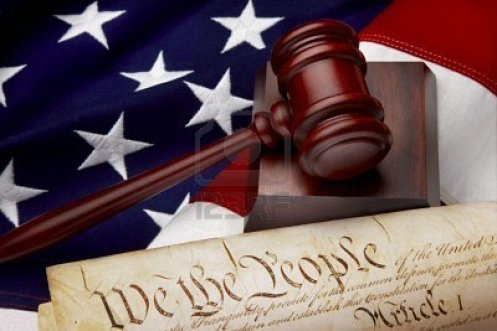 5523701-gavel-and-u-s-constitution-shot-on-american-flag